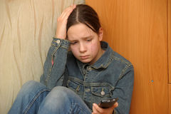 Upset girl with phone Royalty Free Stock Photography