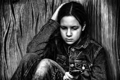 Upset girl with phone Royalty Free Stock Photos