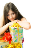 Upset girl with presents. Portrait of a beautiful upset young woman with a lot of presents stock photography