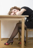 Upset girl  put her head down table. Royalty Free Stock Images