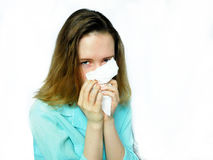 An upset girl with runny nose. Is hiding her nose behind the handkerchief Stock Photography