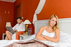 Upset girl sitting bed after fight boyfriend Royalty Free Stock Images