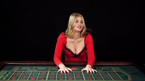 Upset girl sitting near the gaming table, black, slow motion stock video footage