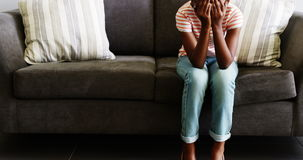 Upset girl sitting on sofa in corridor. At hospital stock footage
