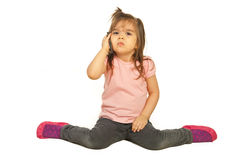 Upset girl speaking by phone mobile Royalty Free Stock Image