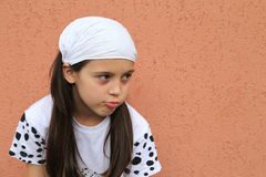 Upset Girl. Young sad Caucasian girl against brown wall background Royalty Free Stock Photo