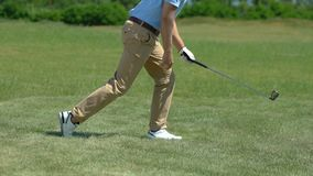 Upset golf player hitting ball and missing, bad position for hit, slow-motion stock video footage