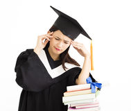 Upset graduate student with  stack of books Stock Image