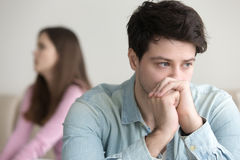 Upset guy deep in thoughts, argument with girlfriend, financial. Sad young men thinking over a problem, guy frustrated after quarrelling with girlfriend Royalty Free Stock Photos