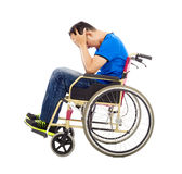 Upset  and handicapped man sitting on a wheelchair Stock Images