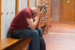 Upset handsome student having a headache Royalty Free Stock Photography