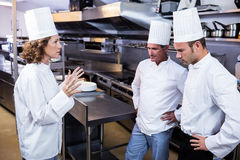 Upset head chef talking to her team Royalty Free Stock Photography
