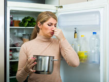 Upset housewife with foul meal Royalty Free Stock Photo