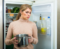 Free Upset Housewife With Foul Meal Royalty Free Stock Photo - 81620245