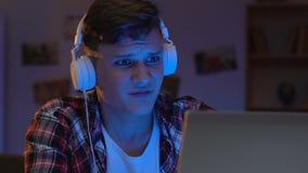 Upset internet player loosing round, video game addiction, aggressive behavior. Stock footage stock video
