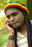 Upset Jamaican on the phone Stock Photography