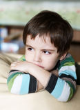 Upset kid. Portrait of cute upset offenced lonely little boy Stock Photography