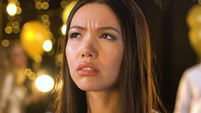 Upset lady having fiber at party, suffering from headache and touching forehead. Stock footage stock footage
