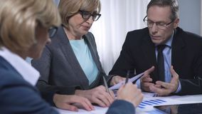 Upset lady manager sighs at the meeting, dissatisfied with report of secretary. Stock footage stock video
