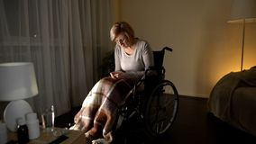Upset lady in wheelchair thinking about children, abandoned patient nursing home royalty free stock photos