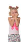 Upset little blonde girl Stock Image