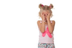 Upset little blonde girl Royalty Free Stock Photos