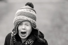 Upset little boy crying out loud Stock Photo