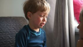 Upset little boy hugging his mother and crying at home. Upset little boy hugging his mother at home stock footage
