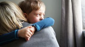 Upset little boy hugging his mother and crying at home. Upset little boy hugging his mother at home stock video footage