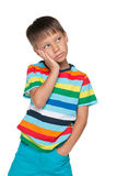 Upset little boy in a striped shirt Royalty Free Stock Images