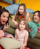 Upset Little Girl. Four little outraged girls at a sleepover Royalty Free Stock Images