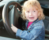 Upset little girl crying in the car Royalty Free Stock Images