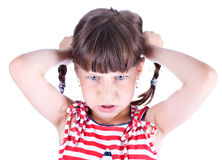 Upset little girl with pigtails Stock Image