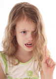 Upset little girl shaking her finger. Stock Photography