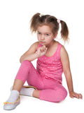 Upset little girl sits on the floor Royalty Free Stock Images