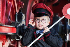 Upset Little Railroad Conductor Stock Image