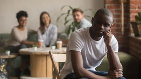 Upset lonely african american man suffering from bullying racial discrimination stock images