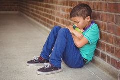 Free Upset Lonely Child Sitting By Himself Royalty Free Stock Image - 58142426
