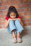 Upset lonely girl sitting by herself Royalty Free Stock Photos