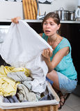 Upset maid looking at clothes Stock Photos