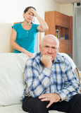 Upset man against wife Stock Photography