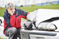 Upset man after car crash stock photo