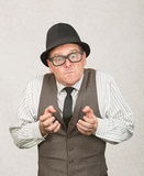 Upset Man Clenching Fists. Single upset businessman with eyeglasses clenching fists Stock Image