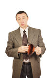 Upset man demonstrates an empty wallet Stock Photo
