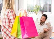 Upset man because of girl`s shopping Stock Photos