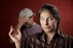 Upset man and guilty woman royalty free stock photography