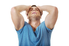 Upset man with hands behind head. Royalty Free Stock Images