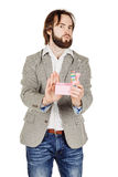 Upset man holding gift box, displeased with what he received, di Stock Photo