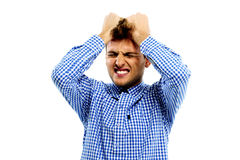 Upset man holding his head Royalty Free Stock Photography