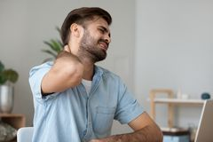Free Upset Man In Pain Touching Stiff Neck Suffering From Fibromyalgia Stock Photo - 138904960